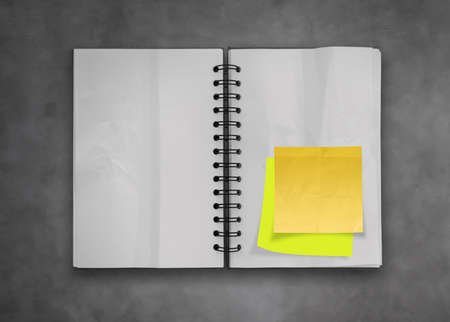 sticky notes with open blank note book on deak top texture Stock Photo - 23401739