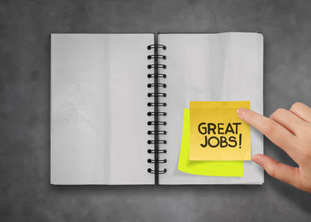 great job word sticky notes with open blank note book on deak top texture Stock Photo - 23401740