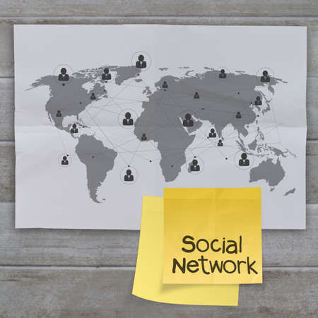hand chain: sticky note social network icon on crumpled paper background as concept Stock Photo