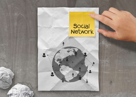 sticky note social network icon on crumpled paper background as concept photo