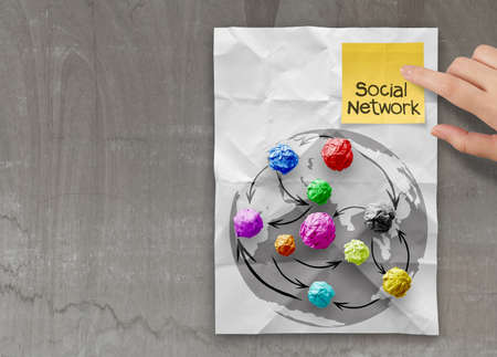 colors crumpled paper as social network structure on wrinkled paper creative concept photo