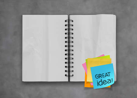 great idea word sticky notes with open blank note book on desk top texture photo