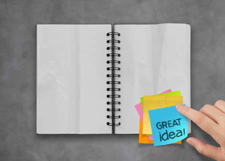 great idea word sticky notes with open blank note book on desk top texture Stock Photo - 23401850