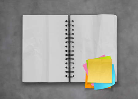 sticky hands:  sticky notes with open blank note book on desk top texture
