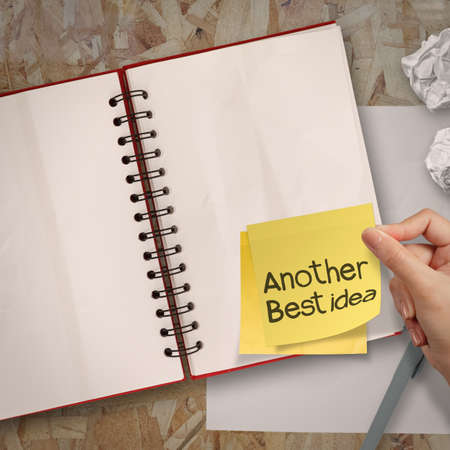 another idea word sticky notes with blank open note book on recycle wood desk top Stock Photo - 23401860