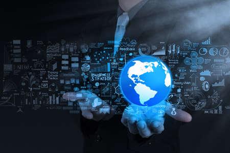 desarrollo económico: espectáculo de la mano de negocios 3d del mundo y la estrategia de negocio como concepto Foto de archivo