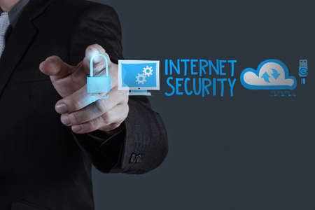 businessman hand touching Internet security online business as concept  photo