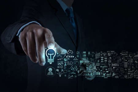businessman hand touch light bulb sign and business strategy as concept Stock Photo - 25263907