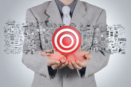 marketing target: businessman hand 3d target sign and business strategy as concept Stock Photo