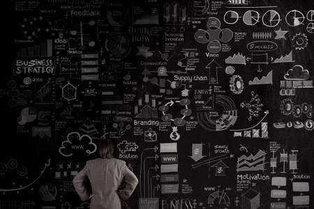 businessman looking business concept and strategy on dark texture wall background as concept photo