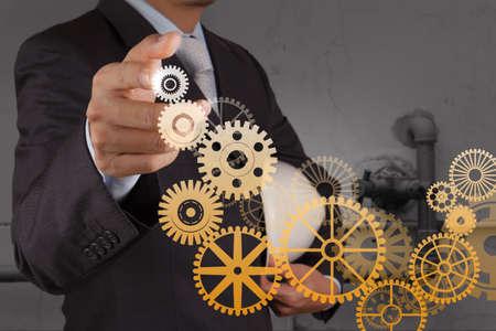 vision concept: businessman hand draws gear to success concept