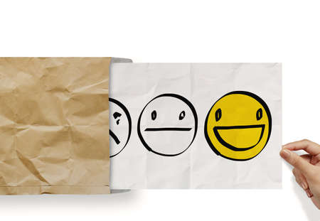 review: hand pull crumpled paper with customer service evaluation icon as concept Stock Photo