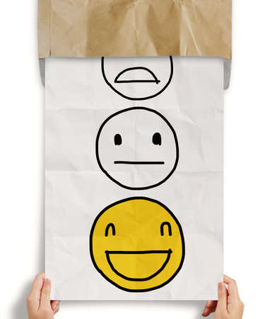 satisfactory: hand pull crumpled paper with customer service evaluation icon as concept Stock Photo