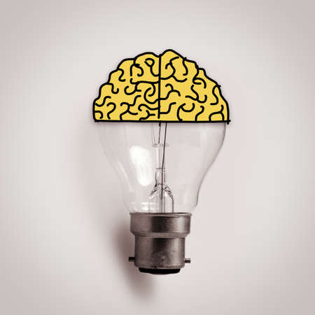 Light bulb with hand drawn brain as creative idea concept photo