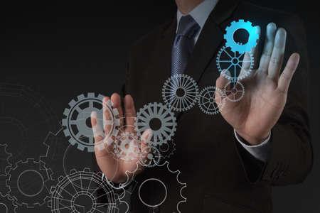 businessman hand draws gear to success concept photo