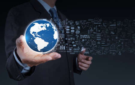 businessman hand the world and business strategy as concept photo