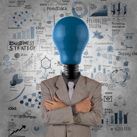 education goals: businessman light bulb 3d blue head with business strategy background as concept