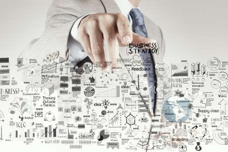 businessman hand pointing business strategy and success diagram as concept