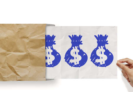 hand pull crumpled paper show dollar sign bag out of recycle envelope as concept photo