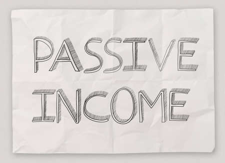 passive earnings: hand drawn of  passive  income on crumpled paper background as concept