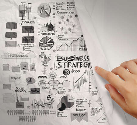 hand drawn point business strategy on crumpled paper background as concept photo