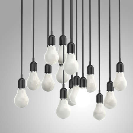 bright idea: creative idea and leadership concept light bulb on grey background