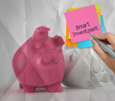 smart investment sticky note on piggy bank 3d standing another fall as concept photo