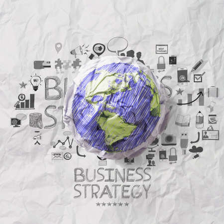 crumpled world and hand drawn business straegy on crumpled paper background  as concept photo