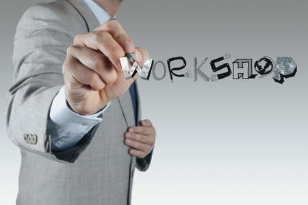 competency: businessman hand drawing design word WORKSHOP as concept Stock Photo