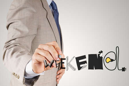 saturday: businessman hand drawing design graphic word WEEKEND as concept Stock Photo