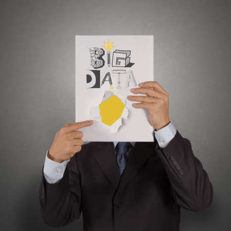 businessman hand show book of  BIG DATA as concept photo
