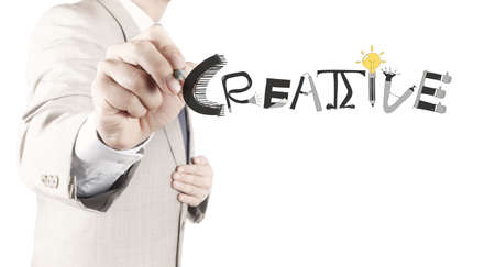 businessman hand drawing design word CREATIVE as concept photo