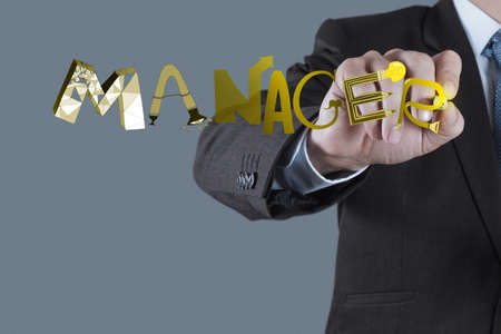 businessman hand drawing design graphic word MANAGER as concept photo