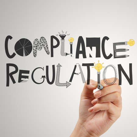 regulations: close of hand pointing to Compliance Regulation designwords as concept