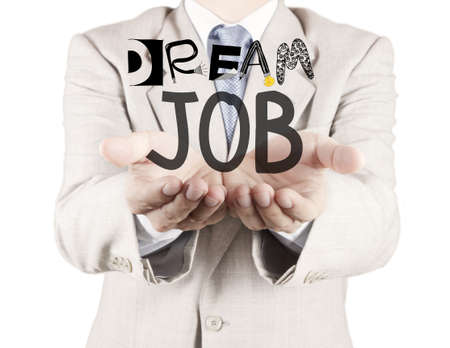 businessman hand show design words DREAM JOB as concept photo