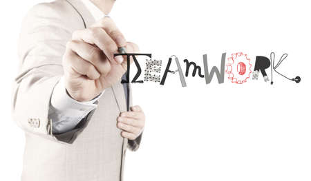 businessman hand drawing design graphic word TEAMWORK as concept photo