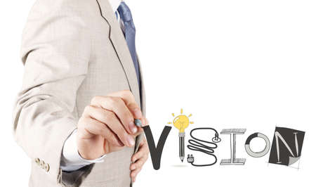 businessman hand drawing VISION design word as concept photo