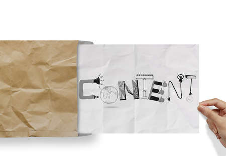 hypertext: hand pulling crumpled paper from envelope with design word CONTENT as concept Stock Photo