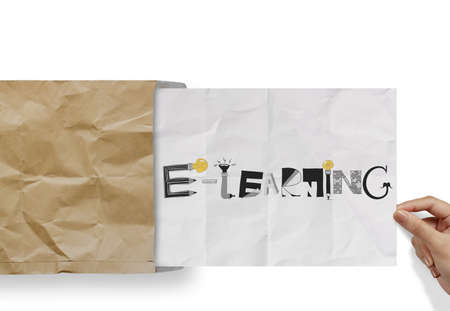 hand pulling crumpled paper from envelope with design word E-LEARNING  as concept photo