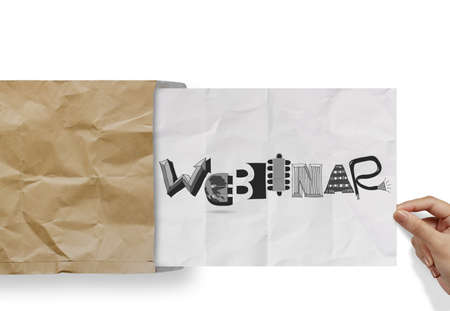 hand pulling crumpled paper from envelope with design word WEBINAR as concept photo