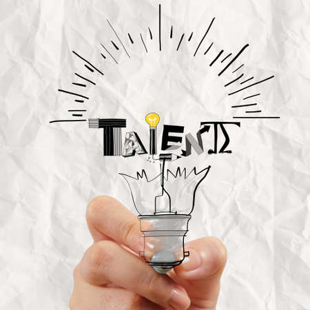 talent management: hand drawing light bulb and TALENT word design as concept