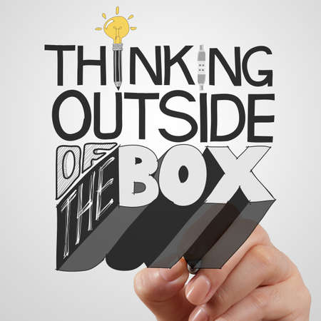 businessman hand drawing design word THINKING OUTSIDE OF THE BOX as concept photo
