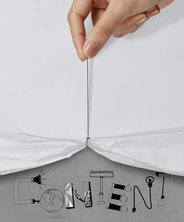 xhtml: business hand pull rope open wrinkled paper show CONTENT design text as concept
