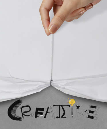 business hand pull rope open wrinkled paper show CREATIVE design text as concept photo