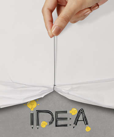 business hand pull rope open wrinkled paper show IDEA design text as concept photo