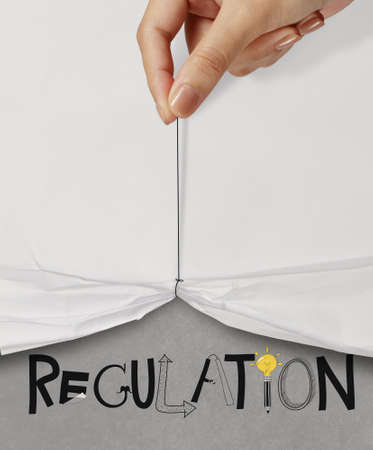 business hand pull rope open wrinkled paper show REGULATION design text as concept