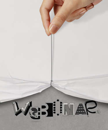business hand pull rope open wrinkled paper show WEBINAR design text as concept photo