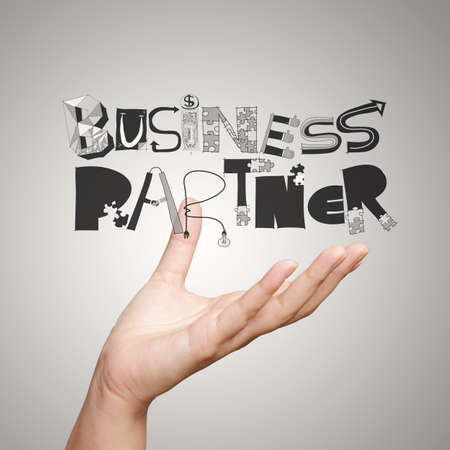 hand showing graphic word BUSINESS PARTNER as concept photo