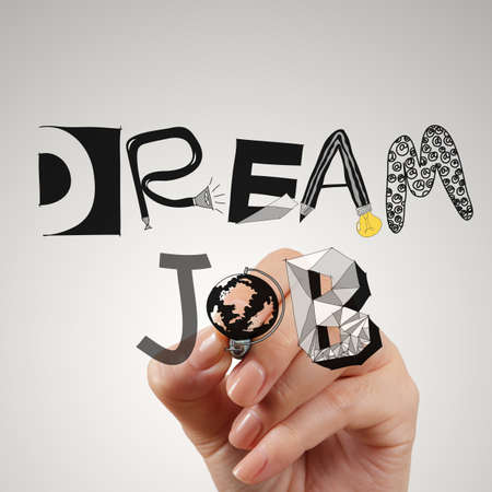 Vacancies: close up of hand drawing design words DREAM JOB as concept Stock Photo