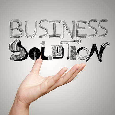 hand showing design word BUSINESS SOLUTION as concept photo